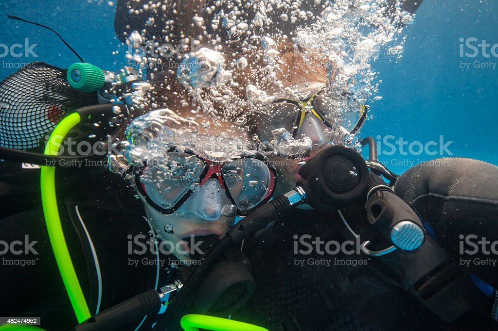 Divers in pool stock photo