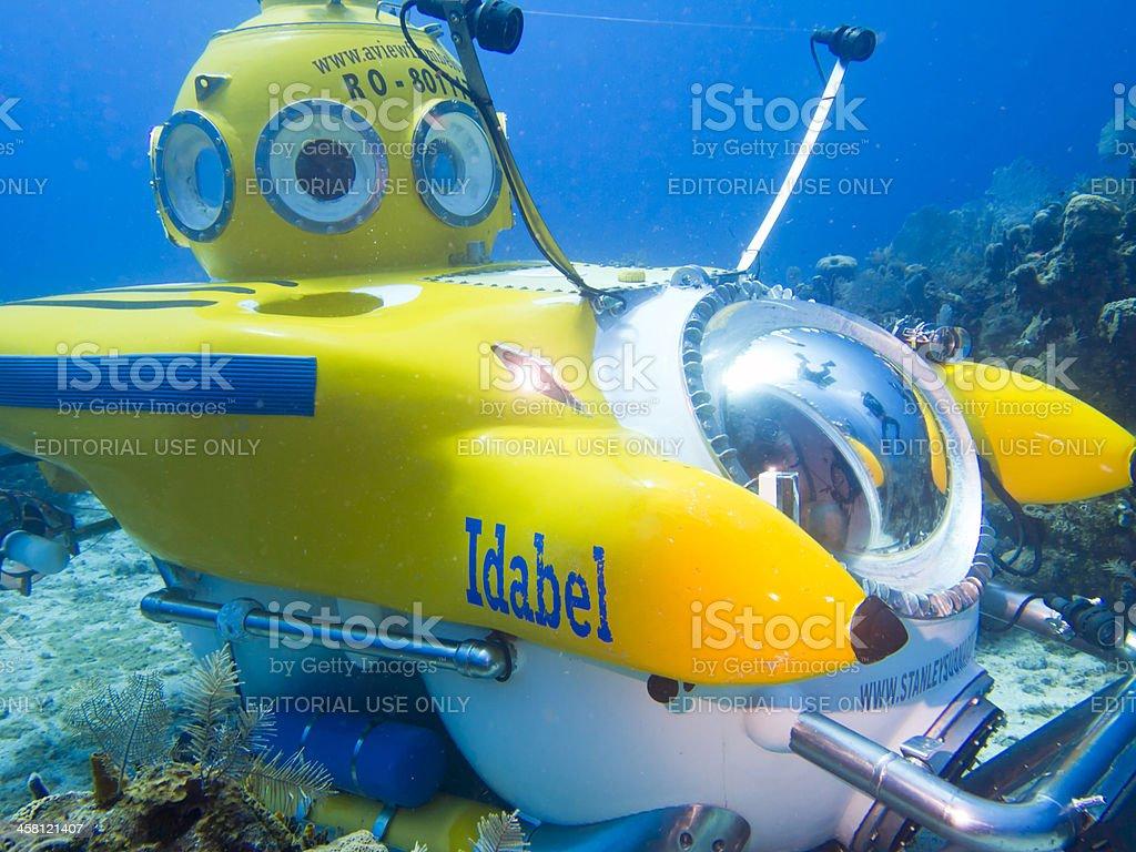 Divers surround submarine royalty-free stock photo