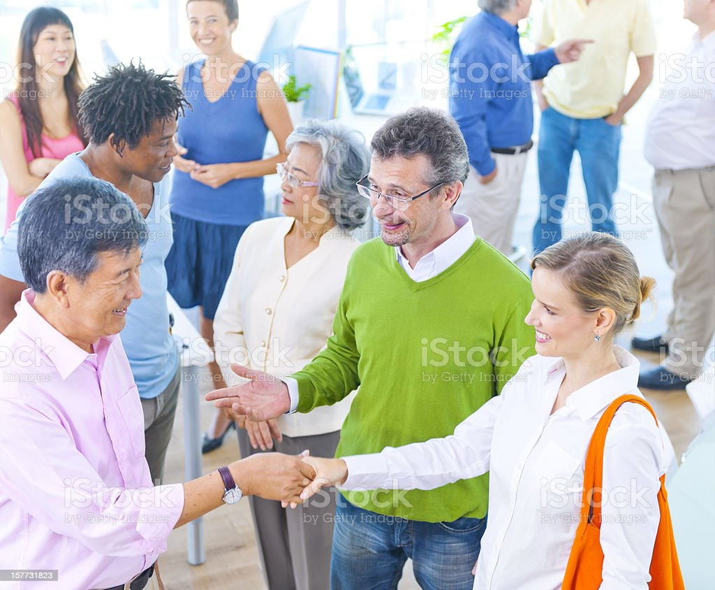 Diverse adults talking together royalty-free stock photo