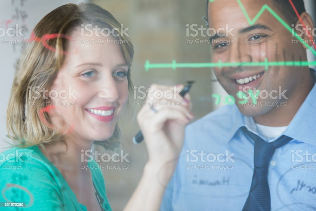 Diverse architects develop plans together stock photo