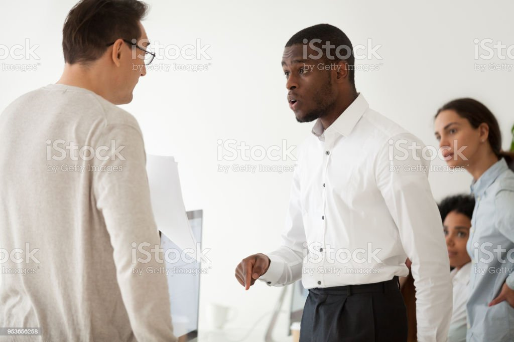 Diverse black employee and white boss arguing in office, african...