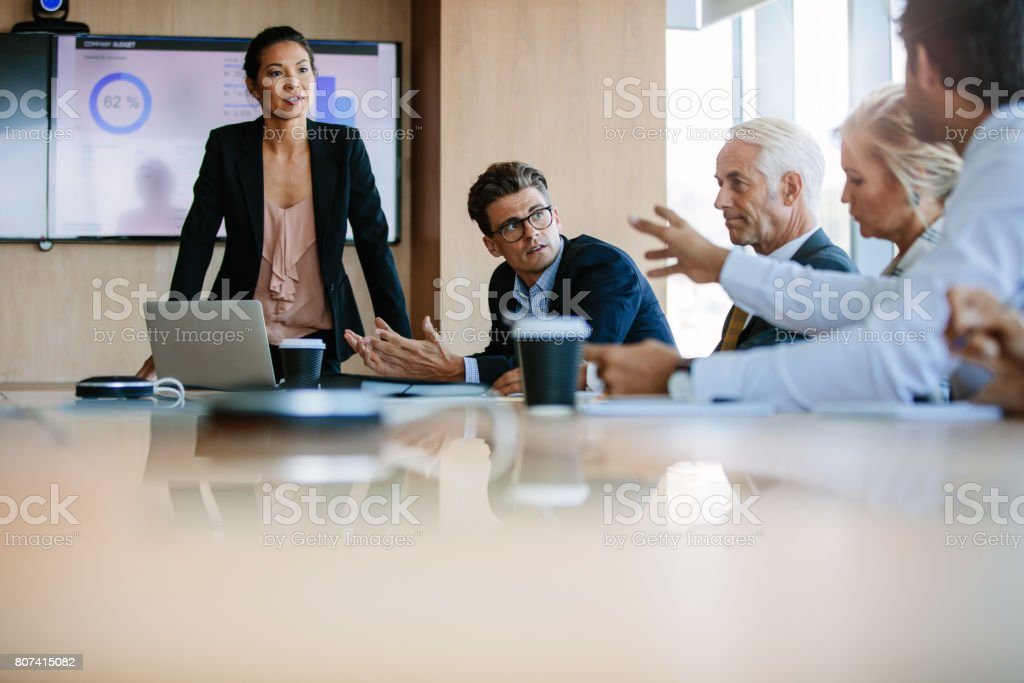 Diverse business group having a meeting in boardroom stock photo