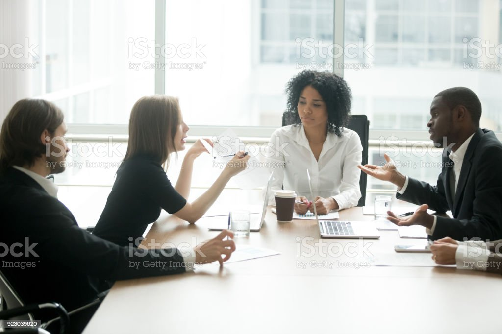 Diverse business partners arguing about bad contract at group meeting stock photo