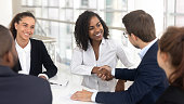 istock Diverse business partners shaking hands starting collaboration at group negotiations 1139630456