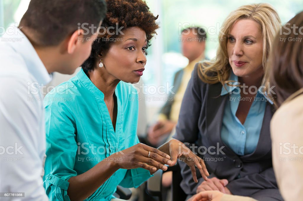 Diverse business people brainstorm during seminar stock photo