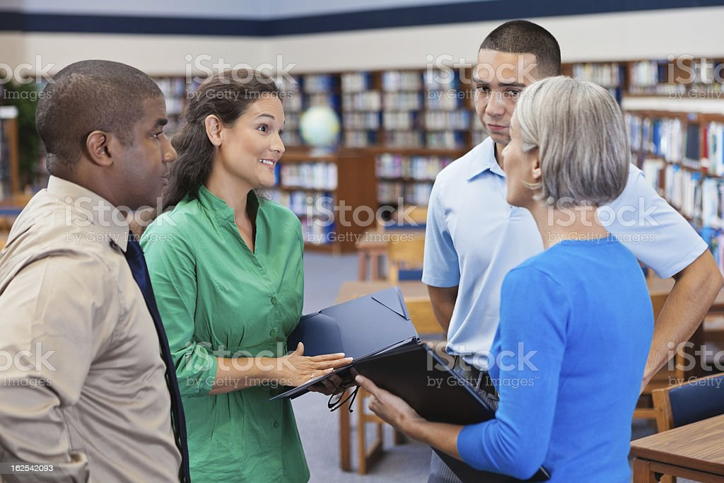Diverse business people discussing something with professional coworkers royalty-free stock photo