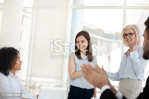 istock Diverse business people greeting newcomer during meeting 1125941844