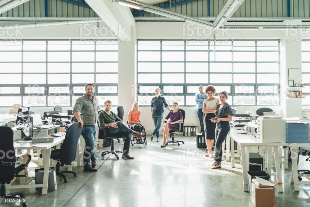 A photo of diverse business people in creative office. Portrait of...