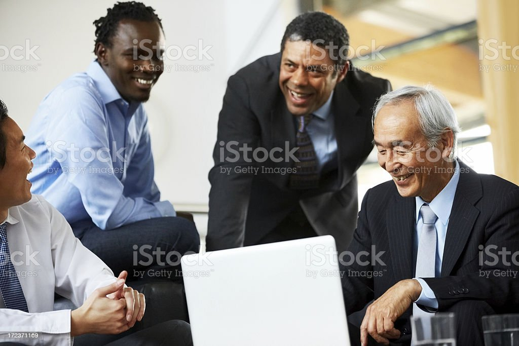 Diverse business people laughing during a meeting royalty-free stock photo