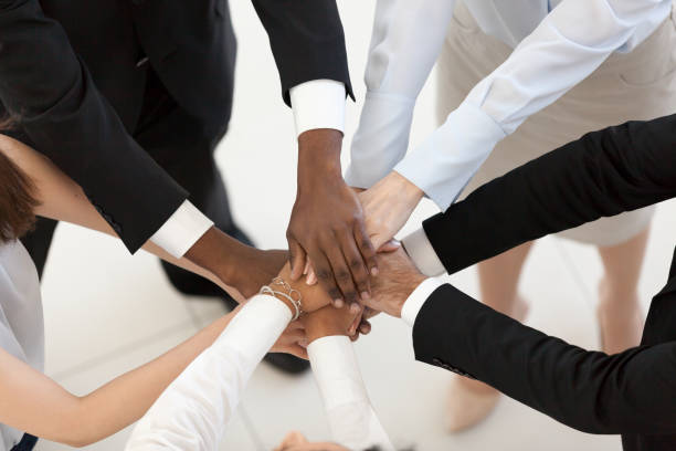 Diverse business people put hands together in pile top view picture id1095047252?b=1&k=6&m=1095047252&s=612x612&w=0&h=qp yypkpjxn2qgb dlt2zzl2tixf7fvn8d8mtep8rjq=