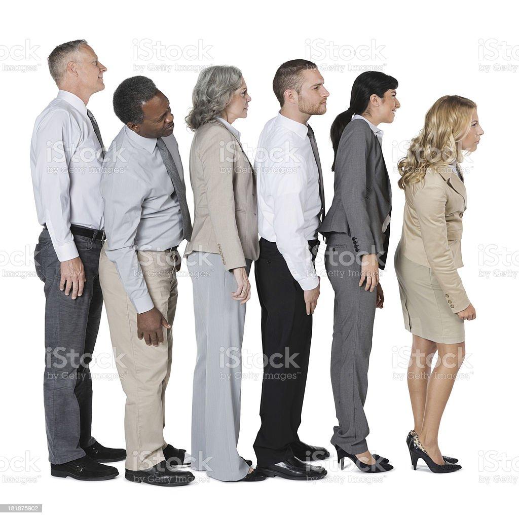 diverse business people standing in line looking ahead