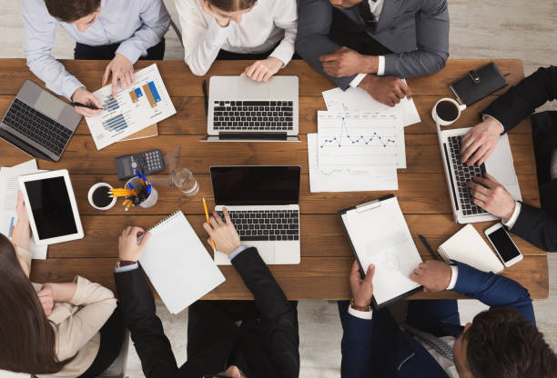 diverse business team at meeting - accountancy stock photos and pictures