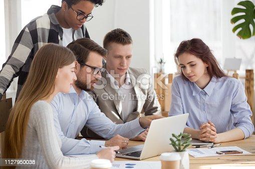istock Diverse business team listen to executive training explain computer task 1127950038