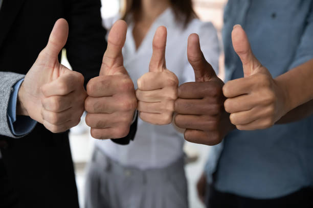 Diverse business team people hands showing thumbs up. stock photo