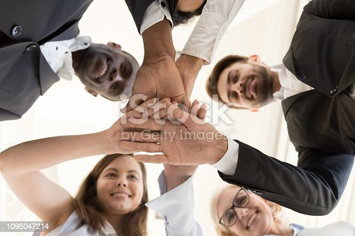 937843262 istock photo Diverse business team put hands together as concept of teambuilding 1095047214