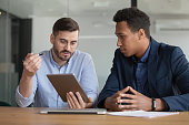 istock Diverse businessmen working on startup project using electronic tablet application 1174262839