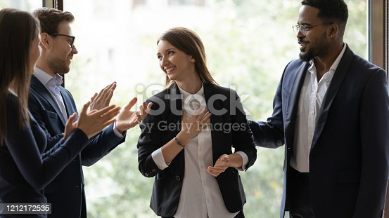 509032417 istock photo Diverse businesspeople applaud greeting with success colleague 1212172535