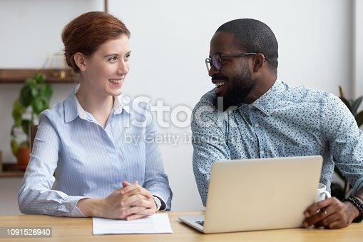 istock Diverse businesspeople client and consultant talking sitting at desk 1091526940