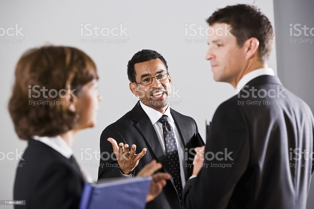 Diverse businesspeople conversing royalty-free stock photo