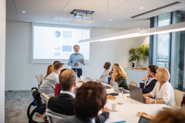 Diverse Businesspeople Listening to Presentation stock photo
