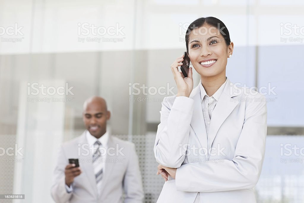 Diverse Businesspeople Using Cellphones royalty-free stock photo