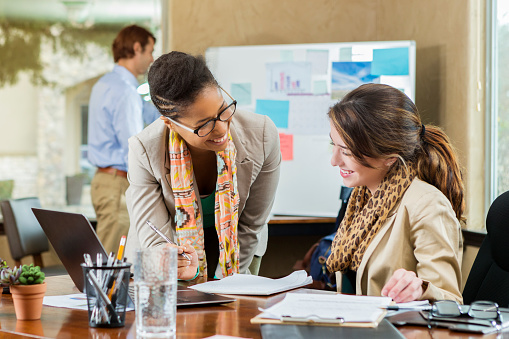istock Diverse businesswomen work together on project 641018138