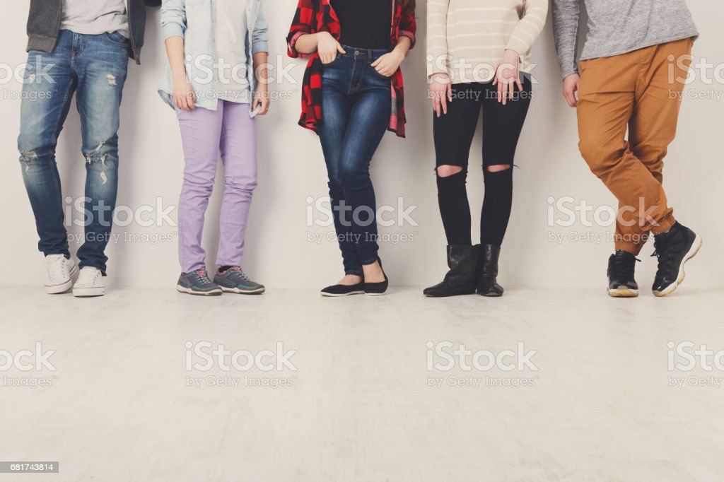 Diverse casual people standing in row indoor, crop stock photo