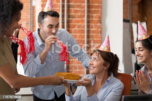 istock Diverse cheerful friendly employees congratulating mature colleague happy birthday 1167824926