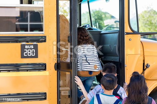 1031397608 istock photo Diverse children board school bus for field trip 1158890081