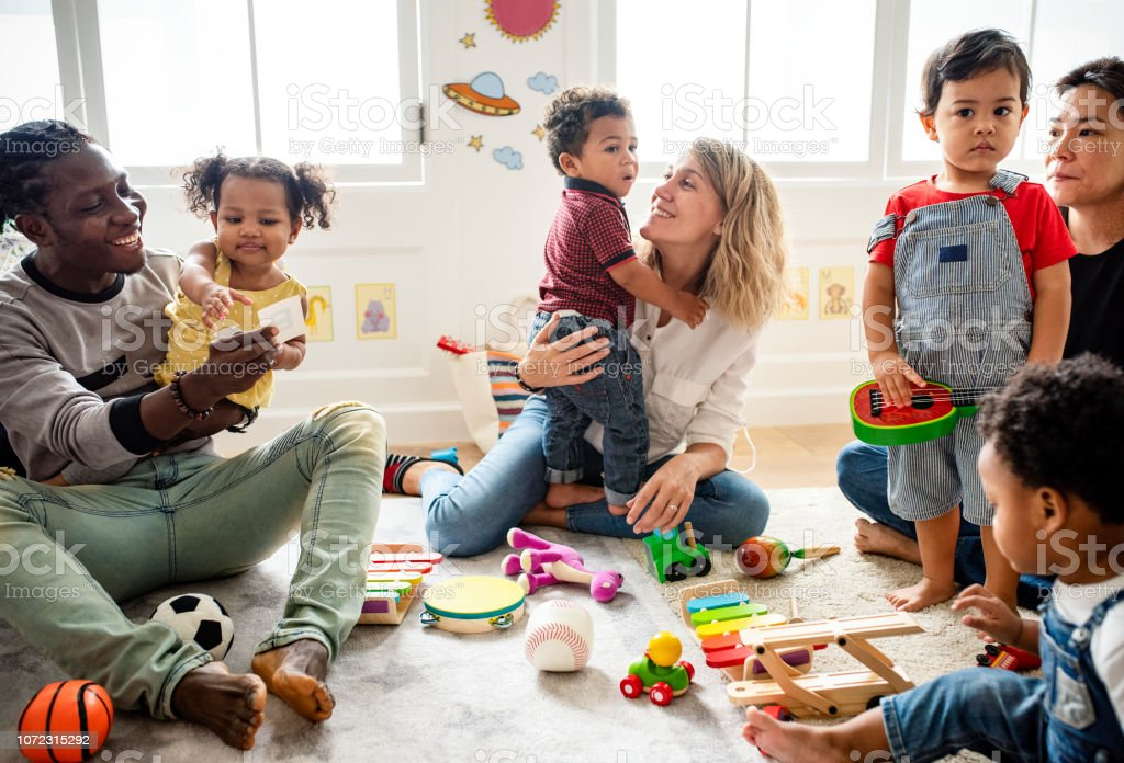 Diverse children enjoying playing with toys stock photo
