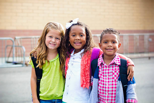 Diverse Children Going to Elementary school stock photo