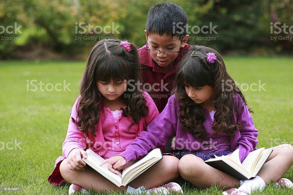 diverse children reading stock photo