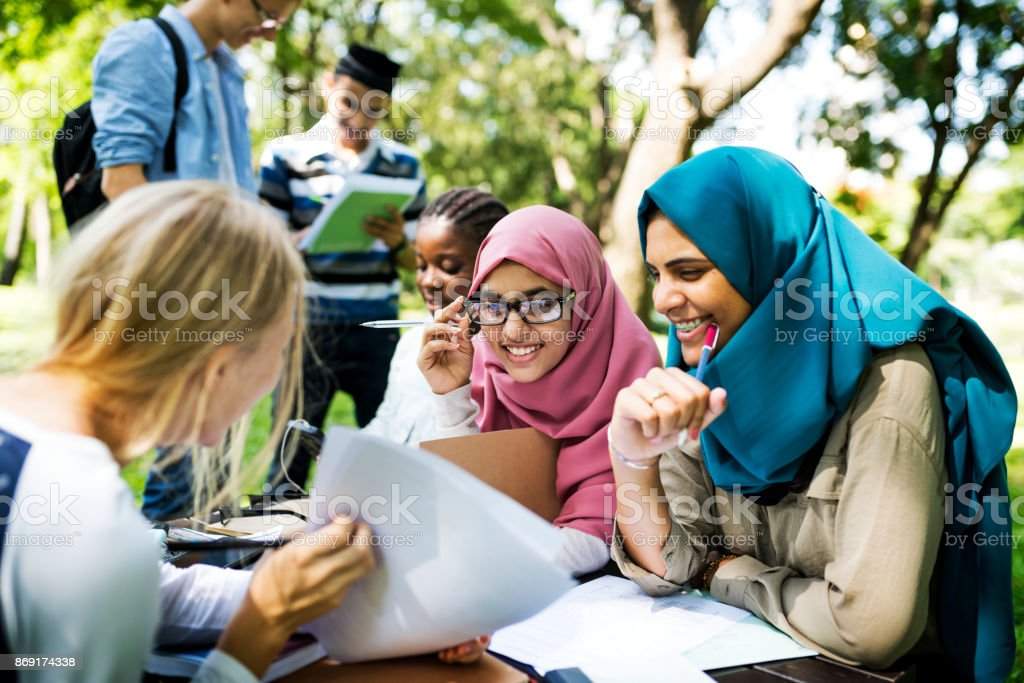 Diverse children studying outdoor stock photo
