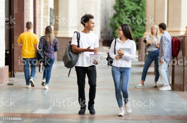 Diverse classmates chatting walking after classes outdoors picture id1174446300?b=1&k=6&m=1174446300&s=612x612&h=dbq18aft7lczbfcbwtixkdfghsqvx0z7ea5ad3udpew=
