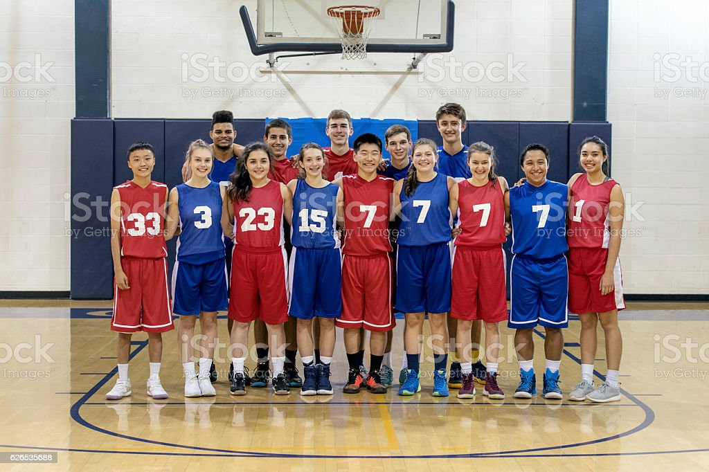 Diverse co-ed group of high school basketball players stock photo