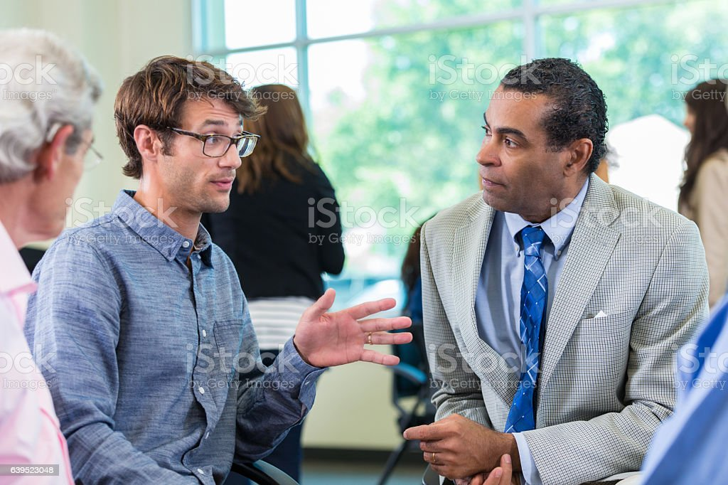 Diverse colleagues attend seminar stock photo
