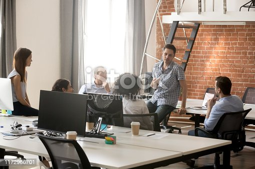 istock Diverse colleagues brainstorm during informal company meeting 1172966701
