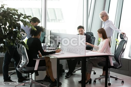 1124783373 istock photo Diverse colleagues busy working in shared office space 1217363362