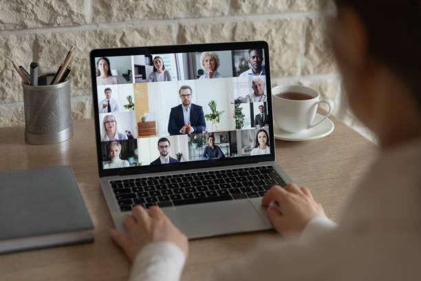 diverse colleagues talk on video call having online briefing - coinvolgimento dei dipendenti foto e immagini stock