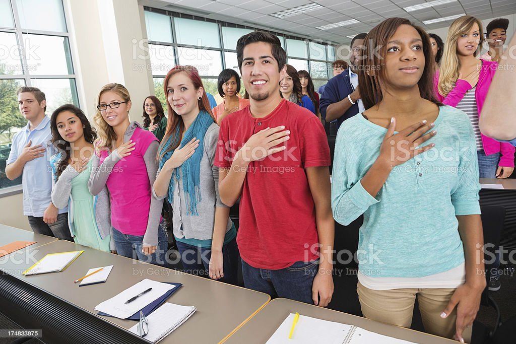 Diverse college or high school class reciting pledge of allegiance stock photo