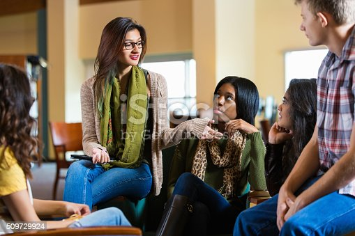 1190039622istockphoto Diverse college students hanging out in library or coffee shop 509729924