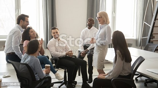 istock Diverse corporate team having coffee break at coworking room 1147384816