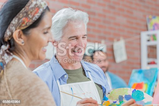 658645980 istock photo Diverse couple in art class 658645964