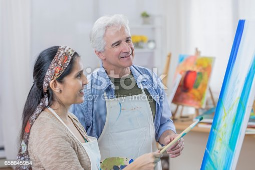 658645980 istock photo Diverse couple paint together in art studio 658645954