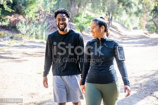 1051098428istockphoto Diverse Couple Walking Fitness 1175053350