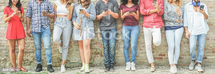 istock Diverse culture people using mobile smartphone outdoor - Happy friends having fun with technology trends - Youth, new generation addiction and friendship concept - Warm filter 848195740