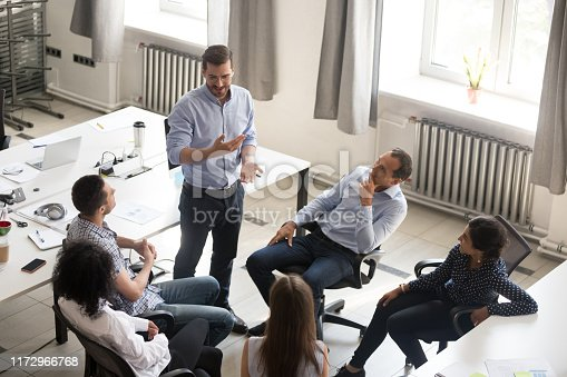 istock Diverse employees brainstorm involved in teambuilding meeting 1172966768