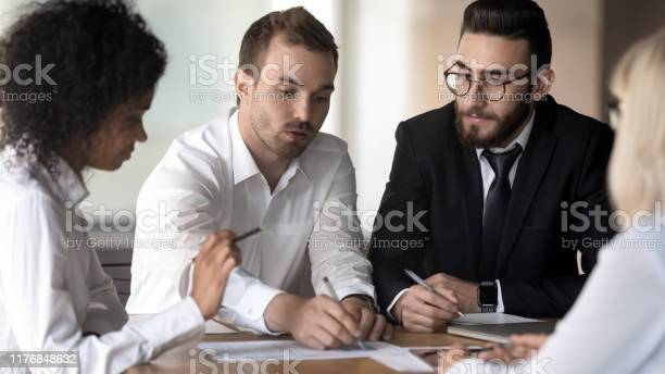 Diverse employees group working on project discussing business picture id1176848632?b=1&k=6&m=1176848632&s=612x612&h=wi5l7zbxeoqy3gjt3oumtanxpb5ycdwh4ph5wpaa ui=