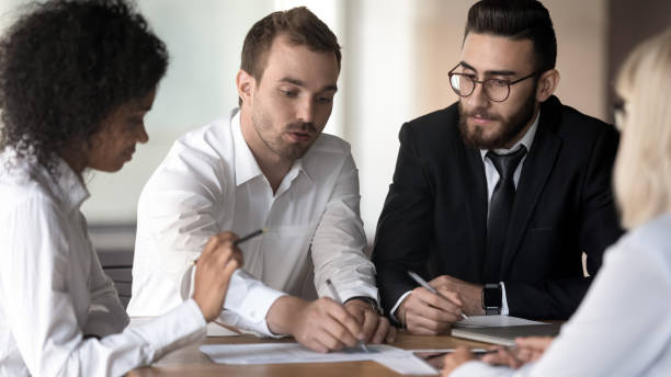 Diverse employees group working on project discussing business picture id1176848632?b=1&k=6&m=1176848632&s=612x612&w=0&h=q9owva3ercdlkttgyaxn6vyz1iz  lboyn3v qw4ypq=