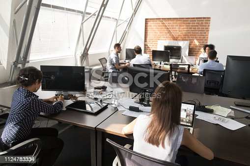 1090214584 istock photo Diverse employees working in coworking open space 1124783334